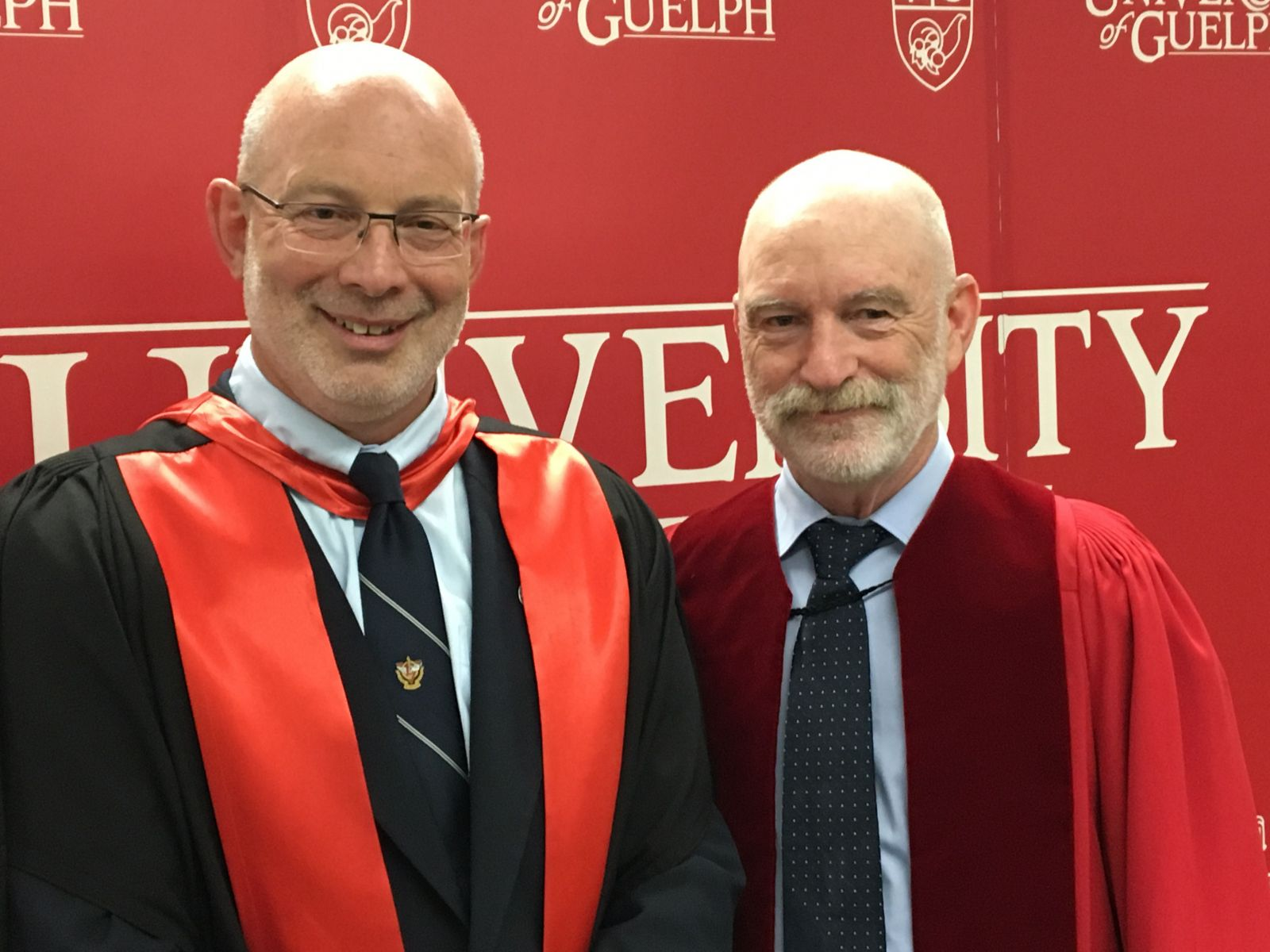 Ontario Veterinary College Dean Jeff Wichtel with Honorary Doctorate recipient Dr. Mike Cranfield, OVC 1977