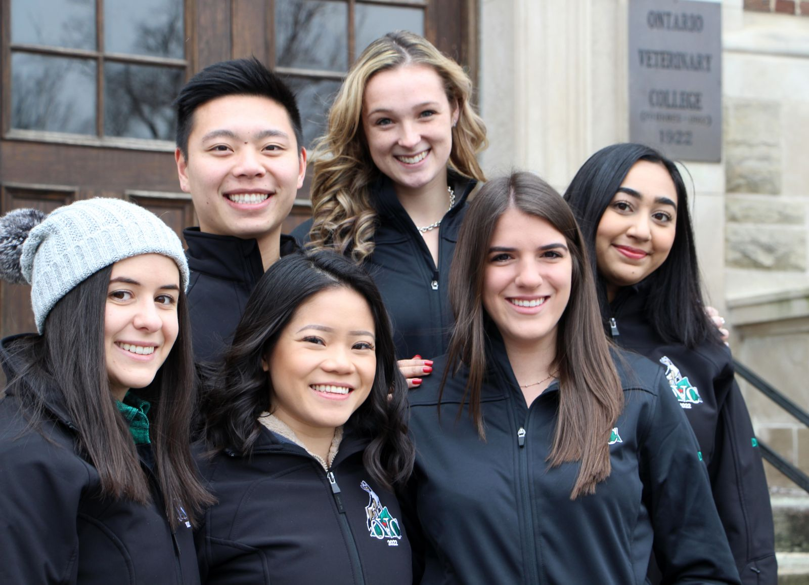 Ontario Veterinary College student veterinarians on the front steps of the college.