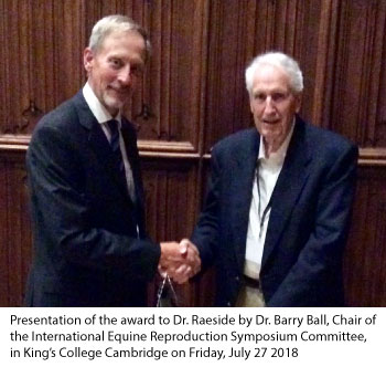 Dr. Barry Ball, Chair of the International Equine Reproduction Symposium, presents Dr. James Raeside with Lifetime Achievement Award.