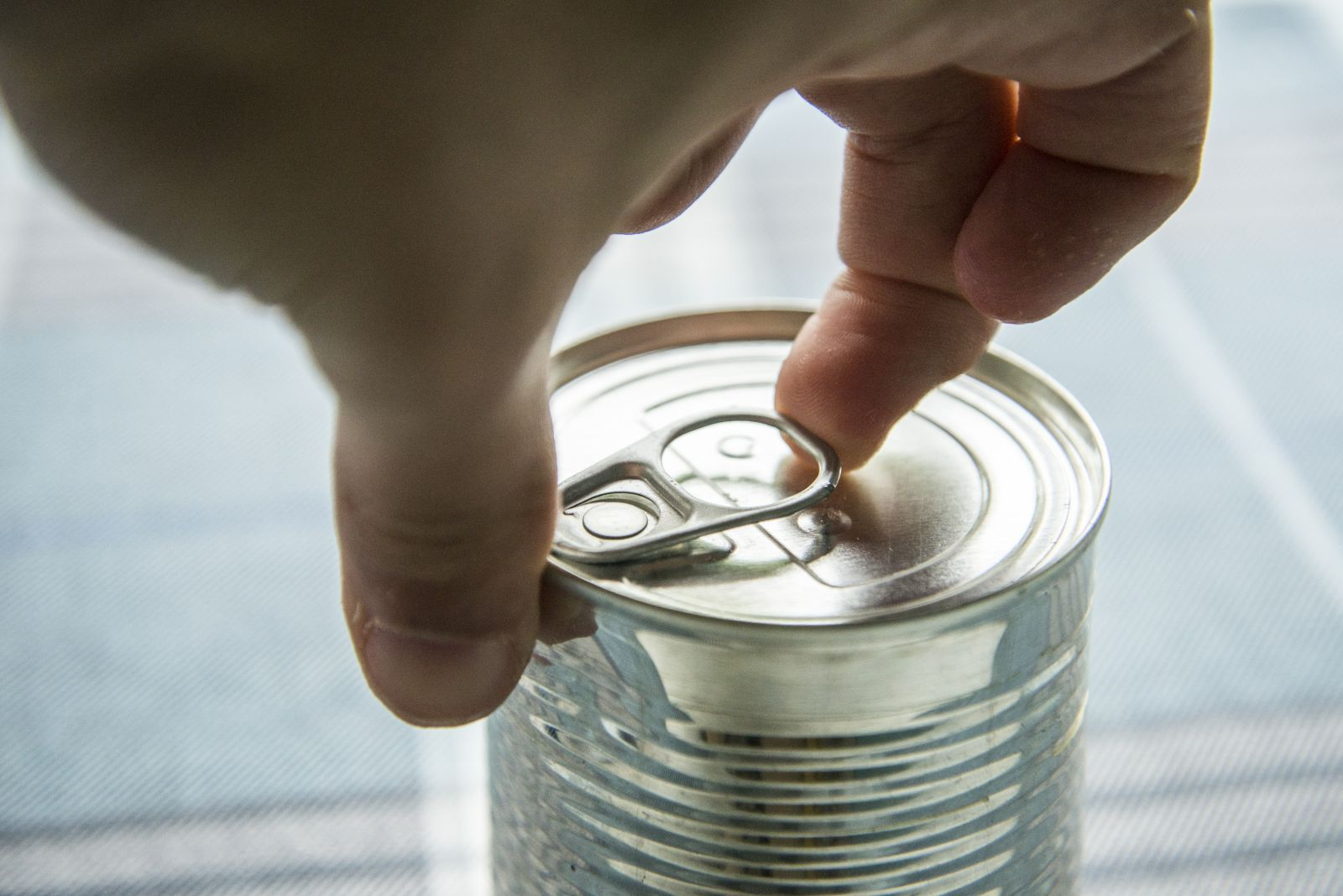 Person opening a can of food (Istock credit: Mario)