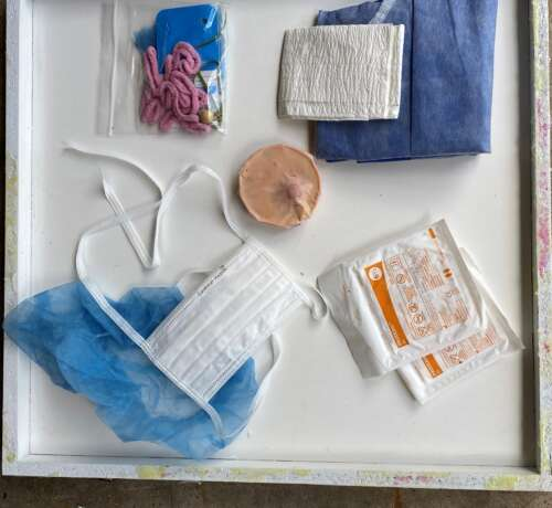 A surgery kit for doctor of veterinary medicine students, with gown, towels to dry hands properly for surgical prep, gloves to practise aseptic skills, caps, mask, oncology model and a spay kit to be used to practise spay procedures.